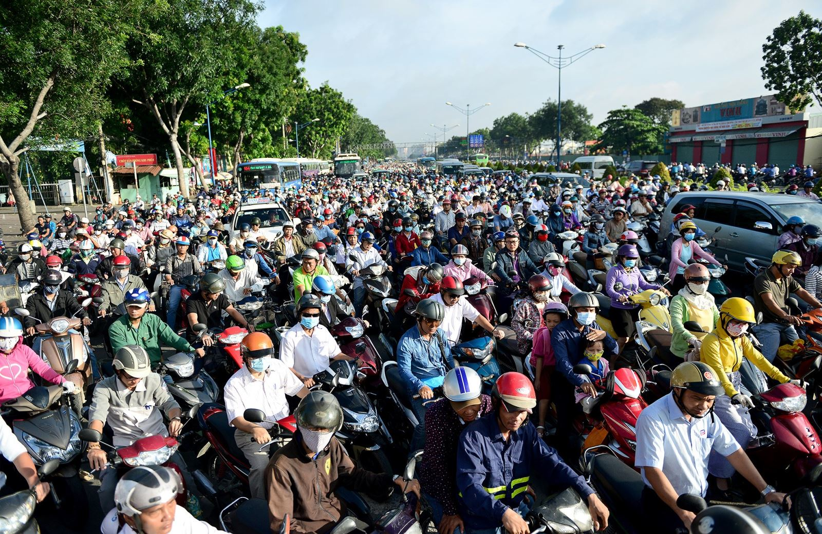 Crowded street full of motorcycles and scooters in Vietnam