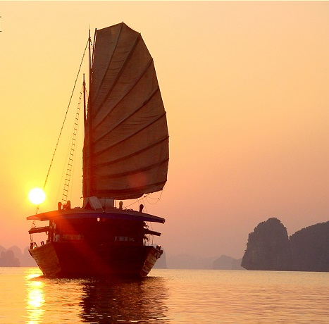 Traditional brown junks in Halong Bay Vietnam